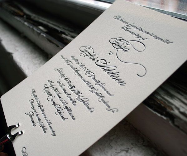 Simple, timeless letterpress and formal airs make delicate swirls with Carlyle wedding invitations.