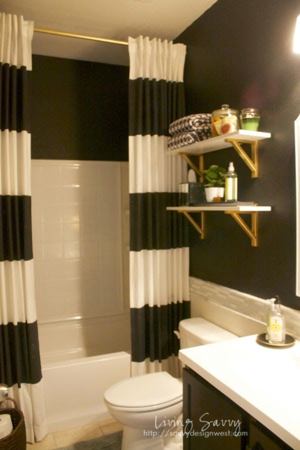 Living Savvy: My House | Black & White Guest Bath Reveal - like the striped curtain and gold shelf brackets