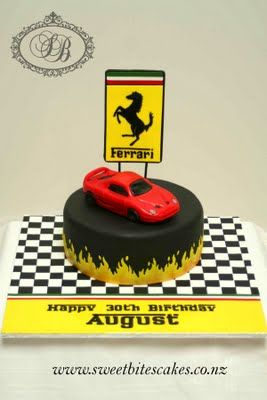 We could replicate the black fondant with flames around the bottom.  We would not include the Ferrari sign that stands on top of the cake.  We would sculpt a ferrari out of rice crispy treats.  It would be 100% edible....covered in fondant and made to look as realistic as possible.