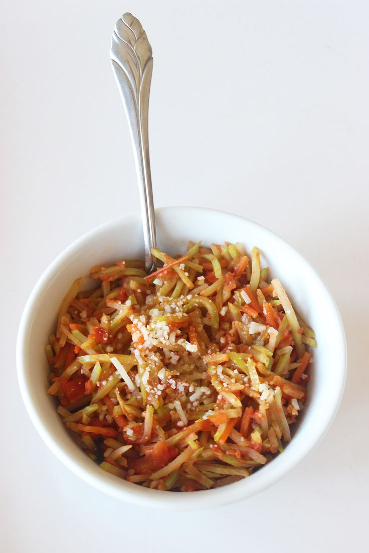 """This cheesy, garlicky recipe from healthy chef Hungry Girl is the best of both worlds — this broccoli slaw """"pasta"""" is as fast to make as any simple pasta dish, and it dramatically cuts back on carbs. Mix up a bowl for yourself and prepare to be amazed."""