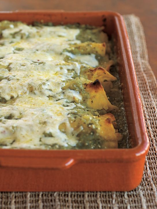 Green Chicken Enchiladas - a huge hit! used about a cup more of onions and twice as much garlic. Also doubled the tomatillos, jalapenos and the broth, which gave us lots of sauce to work with. Put some extra garlic and onions in with the chicken, reserved some onions to go in the tortillas at the end and added extra garlic to the sauce when blending it. We also skipped dipping the tortillas in oil for time reasons.