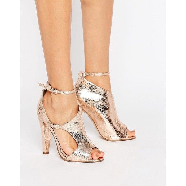 Little Mistress Asymmetric Heel Sandal (160 ILS) ❤ liked on Polyvore featuring shoes, sandals, copper, metallic shoes, metallic heel sandals, ankle strap heel sandals, cut out heeled sandals and high heeled footwear