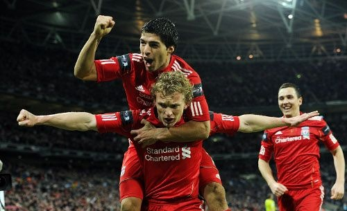 Luis Suarez congratulates Dirk Kuyt