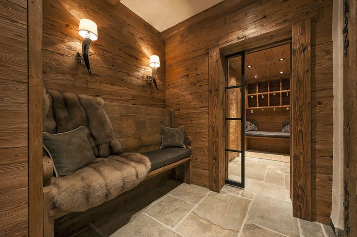The luxury Chalet Annelies is the perfect mountain retreat for family and friends, boasting entertainment and cinema rooms, built-in spa facilities, and a bar.
