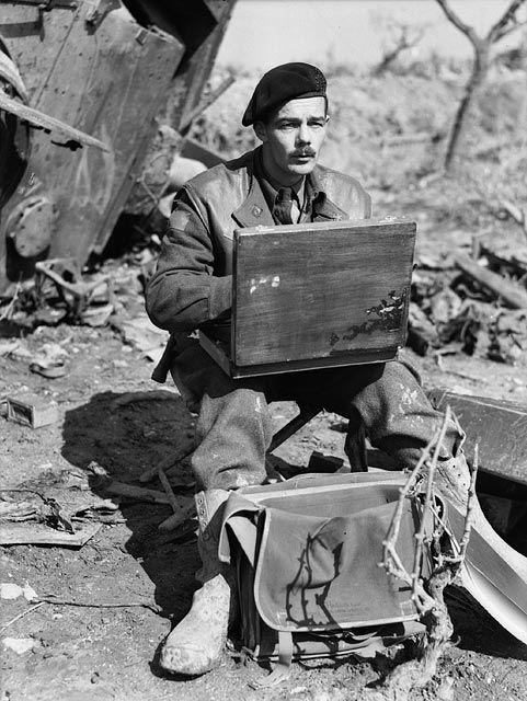Canadian Capt. Lawren P. Harris, official war artist, sketching; Italy
