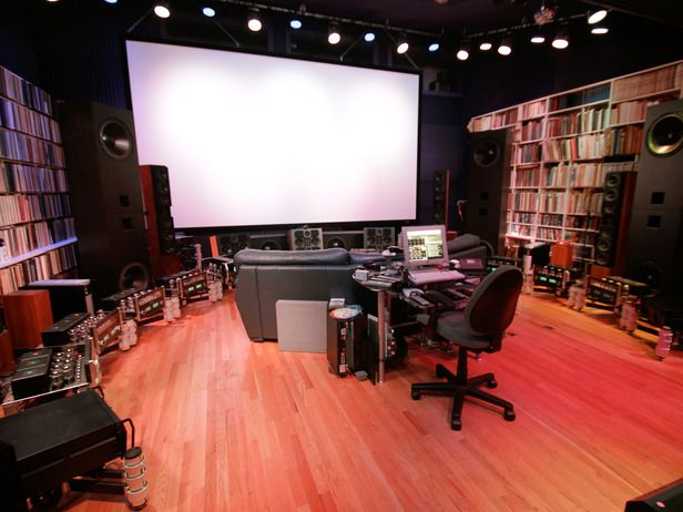 The listening room and home theater features a massive video screen and a huge collection of vintage vinyl recordings.