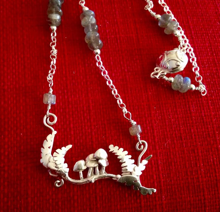 Made by Helen Green - silver clay shrooms & twig, ferns cut from silver sheet, hung on belcher chain with labradorite gemstones.