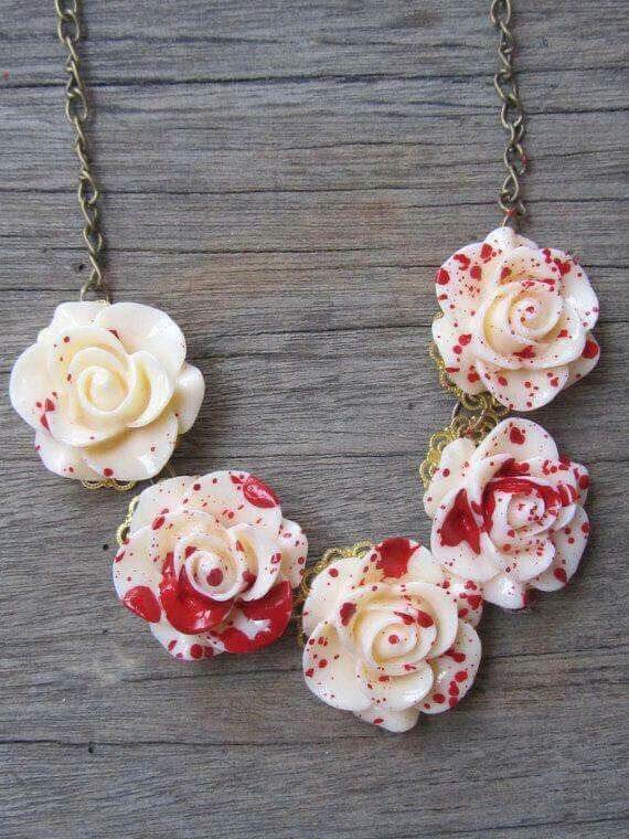 Make white polymer roses and drop red paint over them.