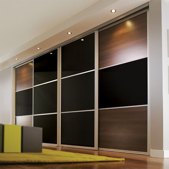 walnut and black glass Maxima sliding wardrobe doors..... grown up luxury.....