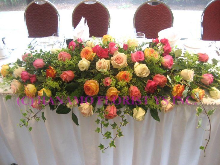 Main table flower arrangements wedh wedding head