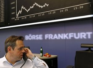 A trader works at desk in front of DAX board at Frankfurt stock exchange<br>A trader works at his desk in front of the DAX board at the Frankfurt stock exchange, Germany, August 24, 2015. REUTERS/Ralph Orlowski