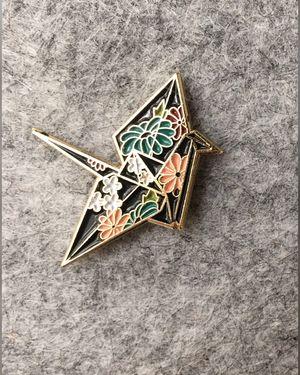 Flowery origami crane enamel pin