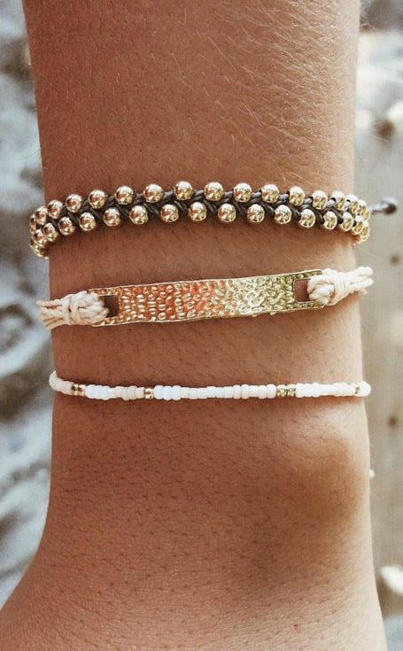 Simple black, white and gold Pura Vida stacking bracelets. Use the code: JENROMANSKI10 for 10% off!