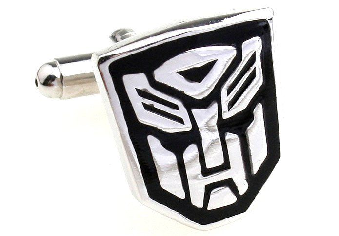 Cufflinks - Transformers Autobot (Black) II    Autobots wage their battle to destroy the evil forces of...The Decepticons.    Every boy-man's favourite. 19mm by 16.5mm.    Made with rhodium plated alloy, which does not tarnish or rust over time. No polishing required.