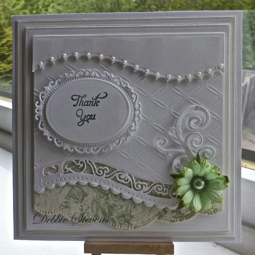 Todays card I have used Spellbinders Grand squares, Spellbinders A2 curved borders, A2 scalloped borders, floral ovals, swirls and flourishes, Embossing folder is 'tied together' , sentiment is from a justrite set. Daisy from wild orchid crafts.