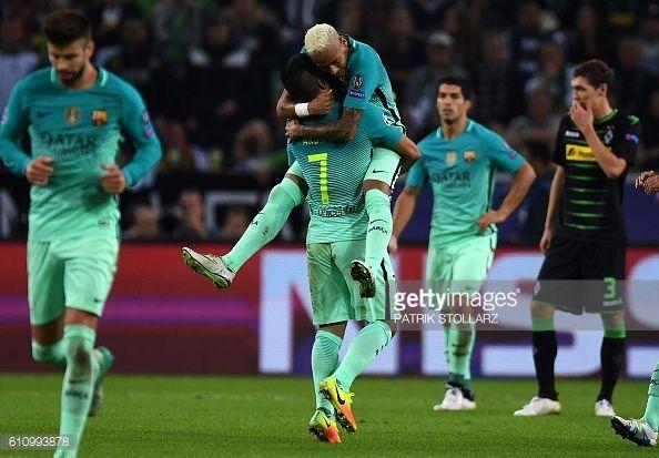 Barcelona's Turkish midfielder Arda Turan celebrate after scoring the 11 equalizer with Barcelona's Brazilian forward Neymar during the UEFA...