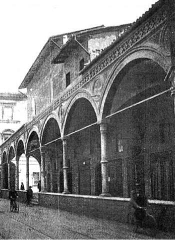 Bologna, strada Maggiore. Sotto il Portico dei Servi c'erano negozi (1930 circa)  http://www.bolognachecambia.it/index_htm_files/552.jpg