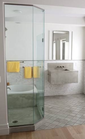 Use tile by the sink and shower area and transition to ...
