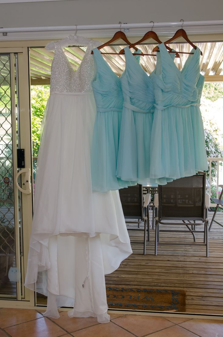 Wedding Photographer - Candid Photos of a Lifetime  White diamante bodice with tuelle skirt with long train for the bride, and teal dresses for the bridesmaids