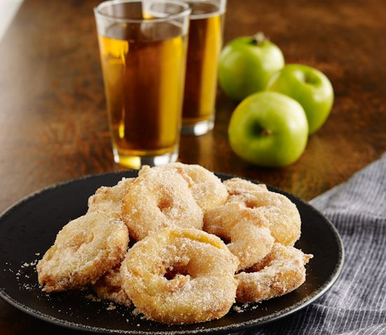 Slices of tart Granny Smiths are dragged through a slightly sweet batter bettered by a toasty lager, and deep-fried until the fritters are golden and the fruit is almost custardy. Dusted with Chinese five-spice scented sugar, they are the exotic love children of a doughnut and a pastry, and a seasonal indulgence you will love.