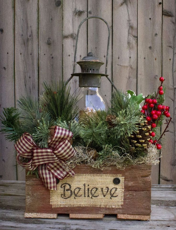 """This gorgeous piece is featured in the Country Sampler Magazine! Reclaimed barn wood box 12""""x12""""x16"""", 16"""" black lantern with battery-operated timer candle, country greens, berries, pine cones, rusty b best #candle #making"""