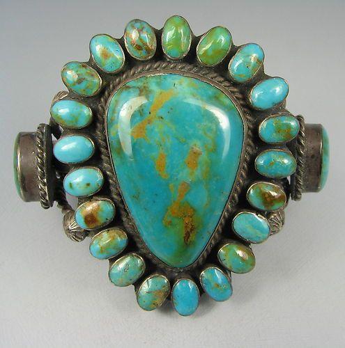 "A huge vintage Navajo sterling silver Pilot Mountain Mine turquoise cluster bracelet,, marked ""T W, Sterling"" inside."