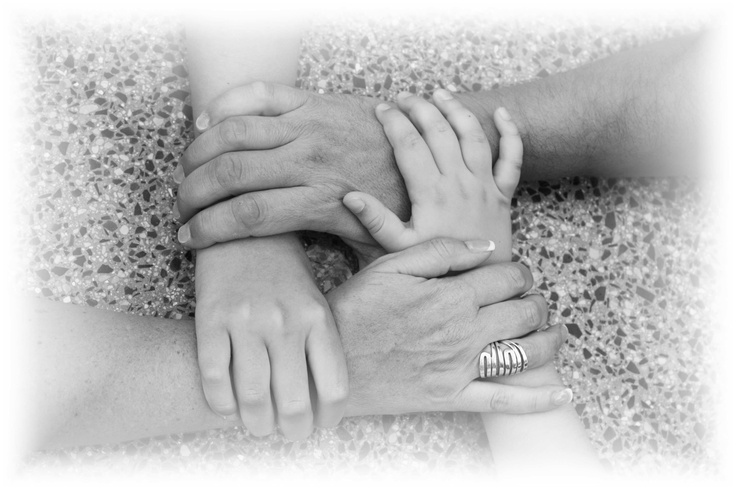 Another hands picture of a family of four.