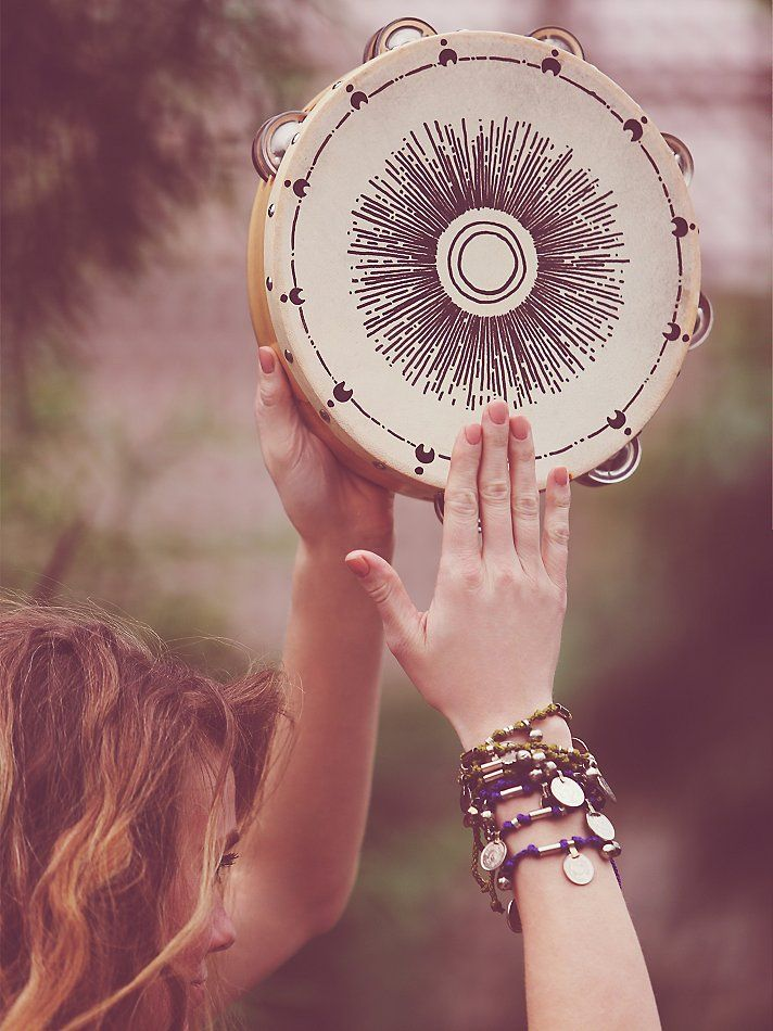 Hand Painted Tambourine | Embody the spirit of the scene with your own energy and rhythm. Hand-painted parchment tambourine with natural grain wood and metal cymbals.