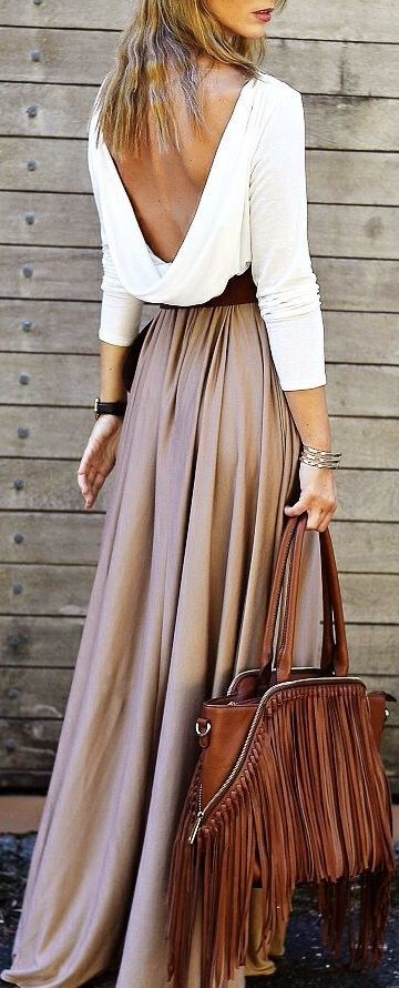 Love this outfit love the open bach white crop top with light brown long maxi skirt and love her bag.