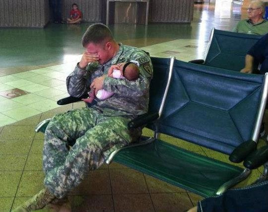 This soldier is about to be deployed and is saying goodbye to his newborn daughter. It's a powerful example of the sacrifices our nation's bravest make every day.