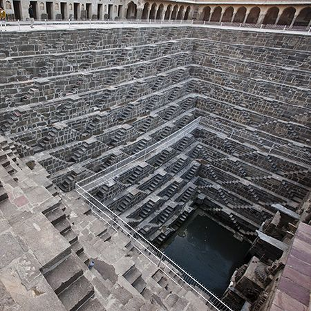 Photographic travel report about the Rajasthan-based step well of Abhaneri in India and its highly symmetric, but yet still very classic Hindu architecture formed by hundreds of steps and dozens of stairs.