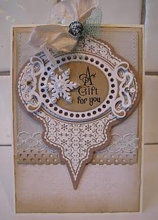 Spellbinders Heirloom ornament die, stamped and embossed in white