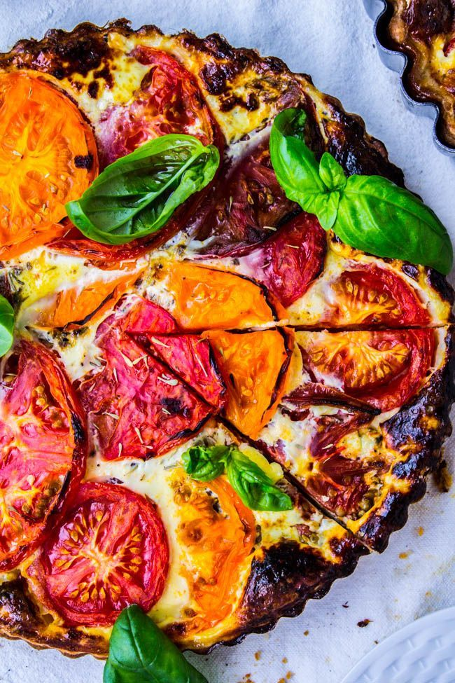 Tomato tart is the perfect ratio of buttery crust to quiche-like filling. It's mostly crust and crispy-topped tomatoes with some blue cheese and cheddar.