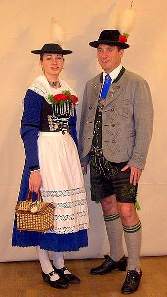 A couple wearing Miesbacher Tracht. The man is wearing traditional Bavarian lederhosen.