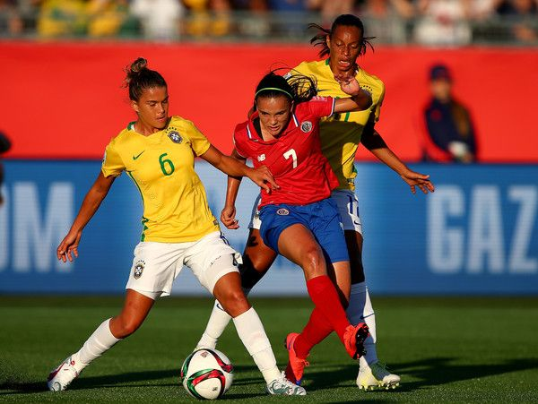 Tamires #6 of Brazil and Melissa Herrera #7 of Costa Rica fight for the ball in the first half