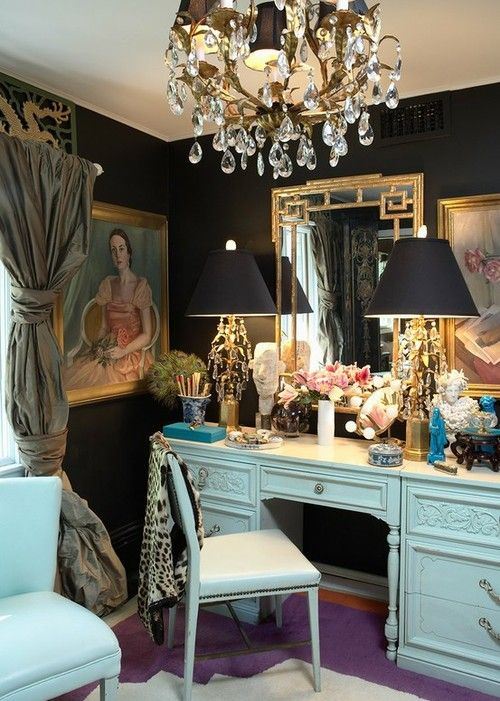 vanity beyond glam.  gold mirror, dark walls, purple rug, and chinoiserie accents.
