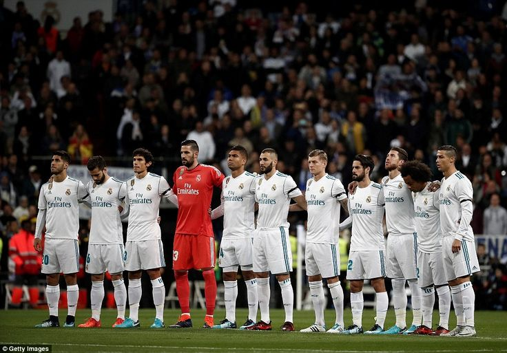 Both sets of players linked together for a minute silence ahead of their La Liga fixture at the Santiago Bernabeu