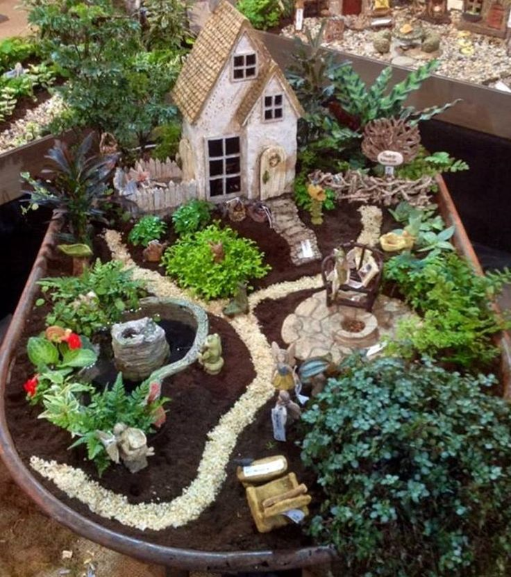 Fairy garden in a wheelbarrow from Small garden fairies