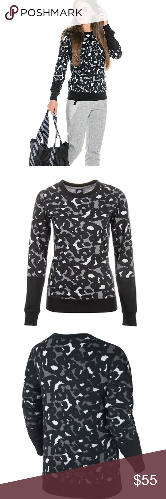 Nike Club Crew AOP Leopard Large Super cute! Size large club crew AOP from Nike.   Change the way you workout with this Club Crew AOP Sweatshirt by Nike. This sweatshirt displays three colours: black, white and grey, a ribbed, crew neckline for a comfortable fit and long sleeves with elasticated cuffs. The animal print enhances this sweatshirt's on-trend finish. Pair this sweatshirt with Nike Club Leggings with Large Swoosh and multi-coloured, Nike wedge sneakers for a fashion-forward touch…