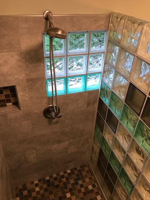 #Creative use of #colors with #clear #wave #GlassBlock for #Shower application #freestanding #wall with finished #End #Block on top and side eliminates the need for #showerdoors! #Love the way they incorporated the replacement #window with the #glass #block #window in the #shower, framed as one unit, lending to more #privacy in the shower and #aesthetically pleasing both #inside and #out!!