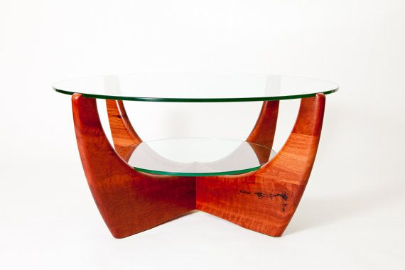 I love this two-tiered coffee table!  Jarrah glass top coffee table with shelf, from Etsy