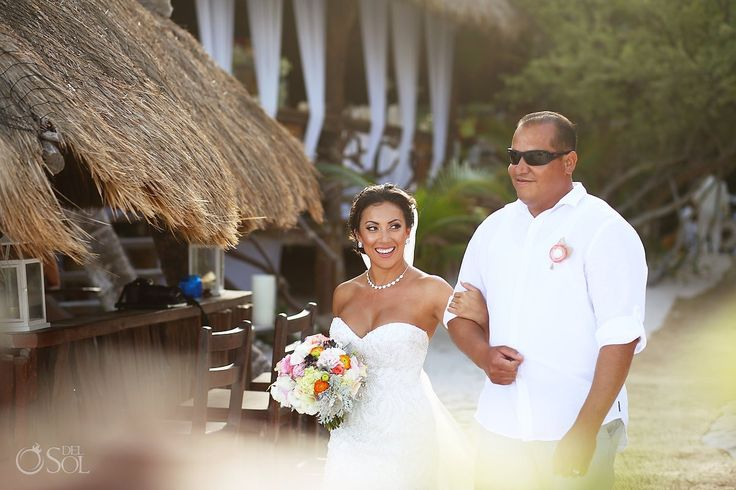 Lovely bride coming down the aisle for her destination wedding at the Akiin Beach Club in Tulum. Mexico wedding photographers Del Sol Photography.