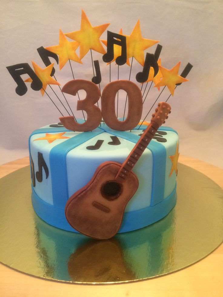Cake with guitar and notes for 30 year anniversary