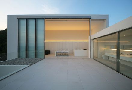 Super large sliding windows and double height living room by Shinichi Ogawa Associates. Nice.