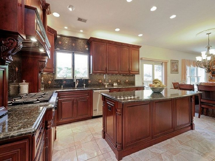 Traditional Kitchen With Cherry Cabinetry And Large Island