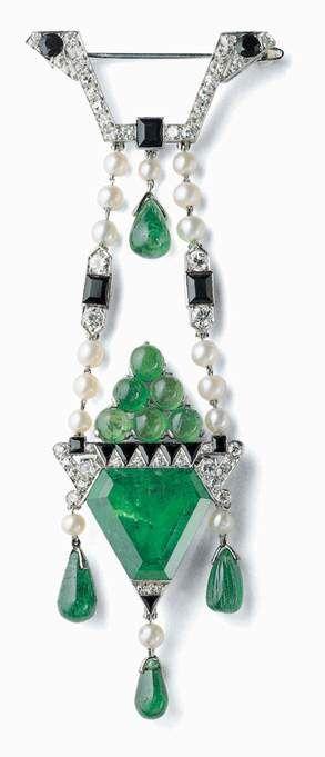 Art Deco Platinum, Diamond,Onyx and Emerald Brooch by Cartier, Circa 1913. Luxurydotcom