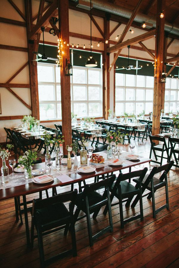 Center piecesindustrial barn wedding reception photo