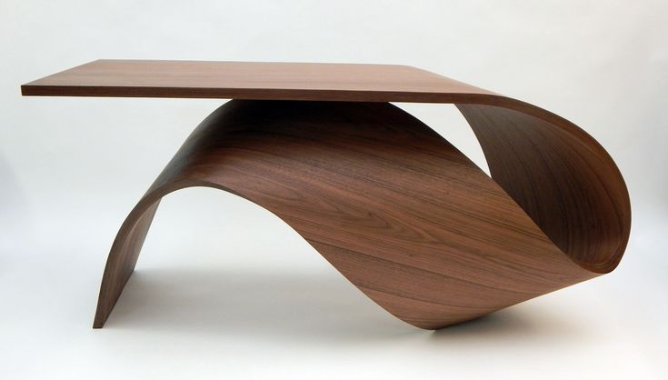French designer Pierre Renard creates flowing shapes with carbon fiber and American walnut veneer