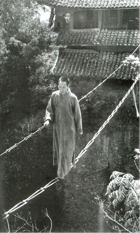 The Jiangyou Figure Hill Temple. Simple iron chain bridge, China, 1930s