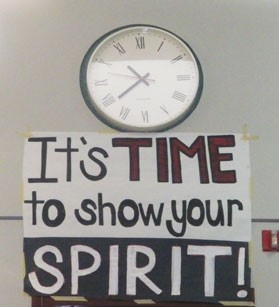 Pep rally sign by clock